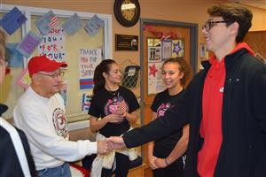 Students visit with veterans