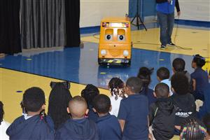 Buster shares safety tips with students