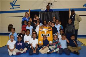 Kindergarten students pose with Buster the Bus