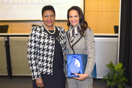 Superintendent Dr. Nettie Collins-Hart (left) recognizes Dr. Lannis Hall for her partnership with Hazelwood School District