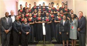 The Hazelwood East Girls' Choir, Dr. Collins-Hart, and district leadership at the MSBA Annual Conference